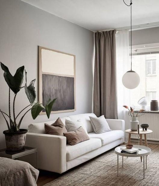 σαλόνι άσπρος καναπές στρογγυλά τραπεζάκια