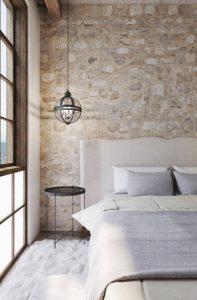 τοίχος από πέτρα στη κρεβατοκάμαρα