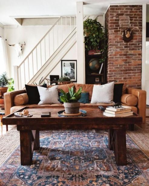 καφέ καναπές ξύλινο τραπέζι