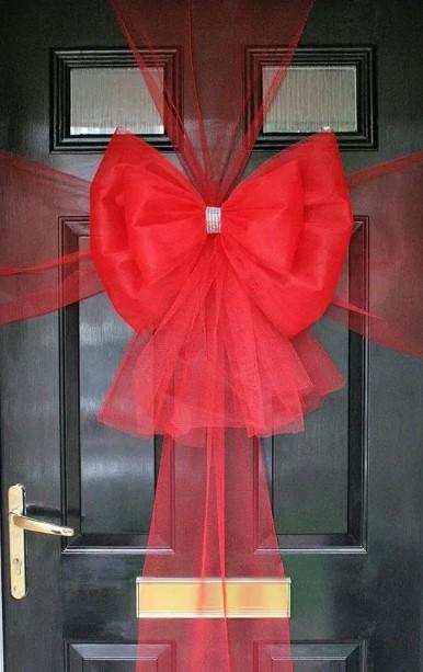 διακόσμηση πόρτας με κορδέλα