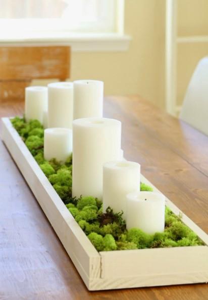 τραπέζι άσπρα κεριά πρασινάδα