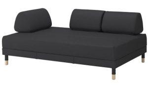 γωνιακός καναπές με στρογγυλά μαξιλάρια και αποθηκευτικό χώρο
